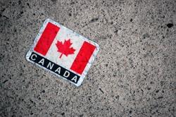 Canadian flag sticker on Canada Day walking along Sussex Street Ottawa Ontario Canada.