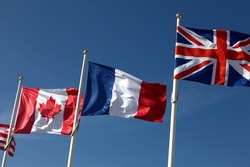 Canadian, french and british flags waving in the wind