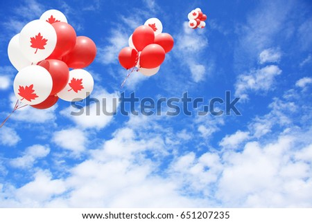Canadian maple leaf flag balloons in the sky for Canada day.  #651207235
