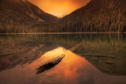 Canadian Mountain Landscape View of glacier water in Joffre Lake during a vibrant summer sunset. Dramatic Colorful Sky Art Render. Located near Pemberton, North of Vancouver, BC, Canada.