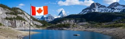 Canadian National Flag Overlay. Beautiful Panoramic View of Og Lake in the Iconic Mt Assiniboine Provincial Park near Banff, Alberta, Canada. Canadian Mountain Landscape Background Panorama.