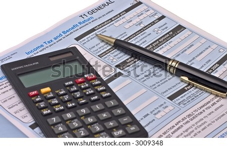 Canadian tax forms with calculator and pen isolated on white