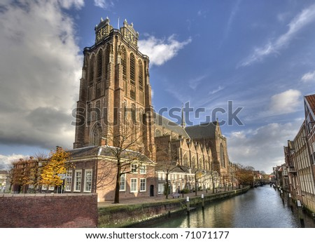 Canal and cathedral in Dordrecht, Holland