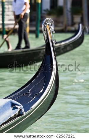 Canal and gondola in Venice, Italy. Retro transportation