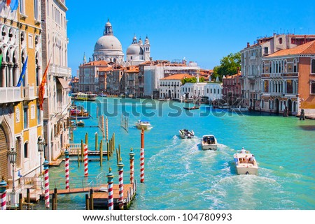 Canal Grande with Basilica di Santa Maria della Salute in the background as seen from Ponte dell Accademia, Venice, Italy - stock photo