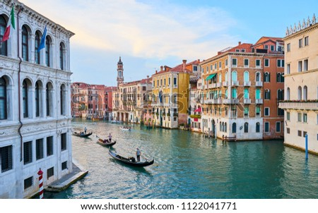 Canal Grande with boats and lights in Venice at Sunset. Gondoliers on Canal Grande #1122041771
