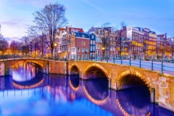 Canal in Amsterdam at night, Netherlands