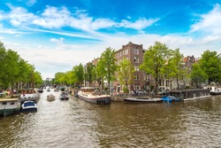 Canal in Amsterdam in a beautiful summer day. Amsterdam is the capital and the most populous city of the Netherlands