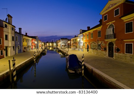 Canal in Burano, Venice, at night with lights