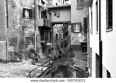 Canal in the old town of Bologna, Italy. Black and white image #500743051