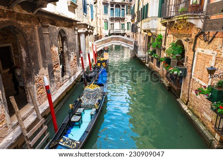 Canal in Venice with gondolas, Italy #230909047