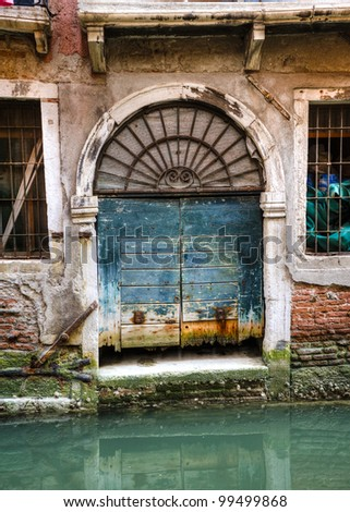 Canal reflections and old buildings in Venice, Italy