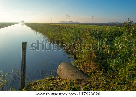 Canal through a rural landscape
