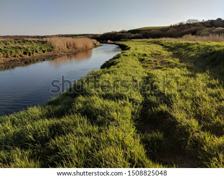 Canal with floodplain and levee bank ストックフォト ©