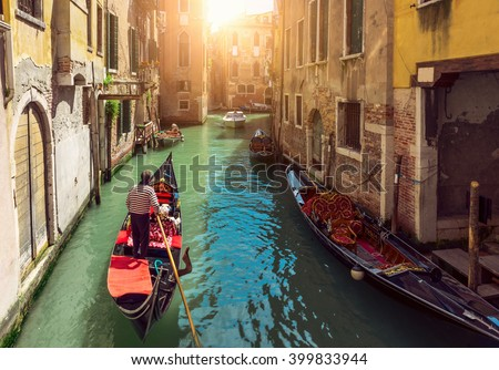 canal with gondolas in venice ...