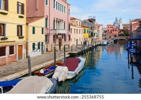 Canals, boats and bridges in Venice, Veneto, Italy #255368755