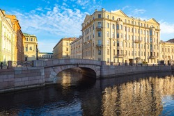Canals of Saint Petersburg. Architecture of Russia. Bridge over the canal in Saint Petersburg. Winter bridge on a summer day. Panorama of Saint Petersburg with a bridge. Guide to Russia.