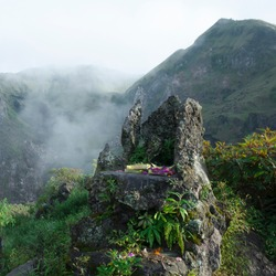 Canang sari on stone altar on top of mount Batur