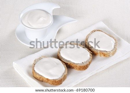 Canape with soft cheese on white background