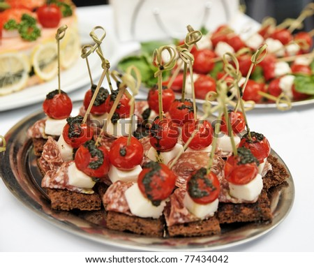 Canapes with choriso wurst on a metal platter stock photo for Canape platters