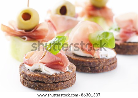 canapes with ham and pickled olives