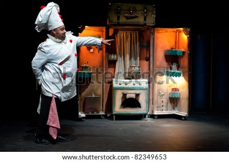 CANARY ISLANDS – AUG 5: Unidentified actor from Teatro Paraiso plays Pied Piper of Hamelin for children onstage during Festival of Theater August 5, 2011 in Las Palmas, Canary Islands, Spain