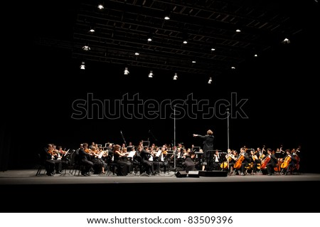 CANARY ISLANDS – AUGUST: 03: Conductor Michael Zlabinger from US, onstage with Otto Edelmann Socity and Sinfonica de Las Palmas, during Festival of Music August 03, 2011 in Canary Islands, Spain