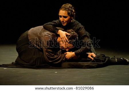CANARY ISLANDS - JULY 14: Actors from Tribuene Teatro in Madrid, playing La Casa de Bernarda Alba, written by Federico Garcia Lorca, during Festival of Theatre July 14, 2011 in Canary Islands, Spain