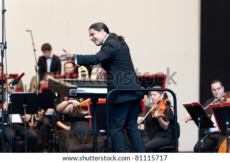 CANARY ISLANDS - JULY 16: Conductor Jose Luis Gomez-Rios born in Venezuela, performing onstage during Festival of Music July 16, 2011 in Las Palmas, Canary Islands, Spain