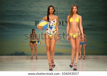 CANARY ISLANDS -JUNE 23: Unidentified models walk the runway in the Red Point collection during Gran Canaria Moda Calida swimwear fashion show on June 23, 2012 in Canary Islands, Spain