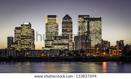 Canary Wharf at dusk, Famous skyscrapers of London's financial district at twilight.