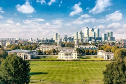 Canary Wharf financial district and Greenwich College in Greenwich park, London, England