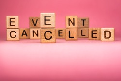 Cancel word on wooden cubes. Cancelled word made with building blocks. Mass gathering cancelled. Repatriation and quarantine of travellers. Travel advice. Protect from coronavirus infection