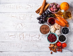 Cancer fighting products. Food for healthy life. Fruits, vegetables, beans, green tea and red wine