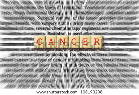 Cancer focus on the word cancer with background radial blur.