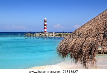 Cancun lighthouse in turquoise caribbean beach