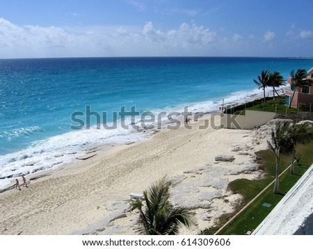 Cancun Mexico white sand beach with blue water on a sunny day