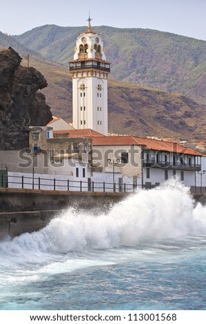 Candelaria church with crushing ocean waves . Canary Island Tenerife, Spain
