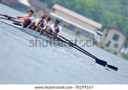 CANDIA, TURIN, ITALY - MAY 22: the Coxless four (straight four) (4-) CUS Torino crew rowing during 2011 Rowing CNU University National Championship on May 22, 2011 on Candia lake, Turin, Italy