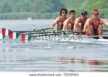 CANDIA, TURIN, ITALY - MAY 22: the CUS dei Laghi quad (quadruple) scull (4x) crew rowing during 2011 Rowing CNU University National Championship on May 22, 2011 on Candia lake, Turin, Italy