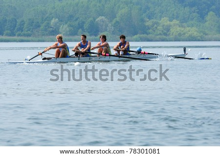CANDIA, TURIN, ITALY - MAY 22: the CUS Pavia coxed four (4+) crew rowing during 2011 Rowing CNU University National Championship on May 22, 2011 on Candia lake, Turin, Italy