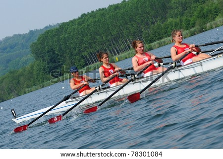 CANDIA, TURIN, ITALY - MAY 22: the female CUS Bari coxless four (straight) (4-) crew rowing during 2011 Rowing CNU University National Championship on May 22, 2011 on Candia lake, Turin, Italy