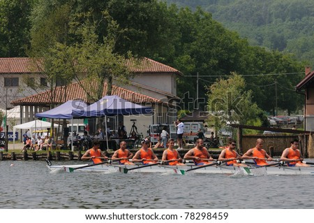 CANDIA, TURIN, ITALY - MAY 22: the octuple scull (8x) coxed CUS Ferrara crew rowing during 2011 Rowing CNU University National Championship on May 22, 2011 on Candia lake, Turin, Italy