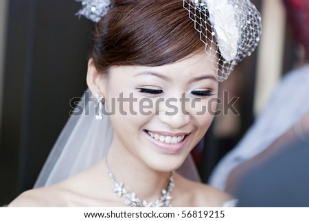 Candid moment of beautiful Asian bride smiling