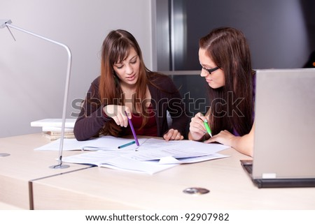 Candid photo of a couple of students studying together