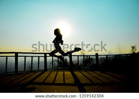 Candid portrait, Silhouette, Little girl dancing on during sunset.
