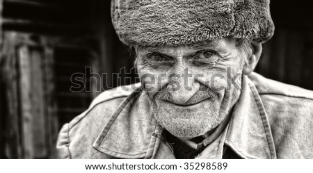 Candid smile of adorable wise senior man