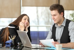 Candid young businesswoman falling in love with a colleague at office