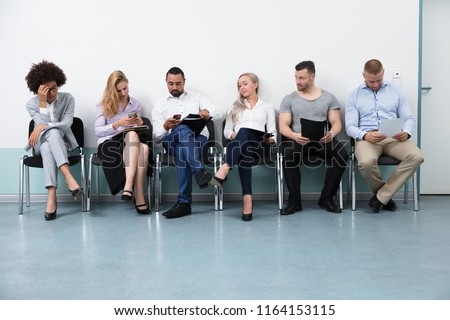 Candidates Sitting On Chair Waiting For An Interview Сток-фото ©