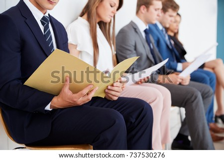 Candidates waiting for job interviews, mid section